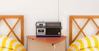 Hotel não deve pagar direitos autorais por músicas tocadas em quartos de hóspedes